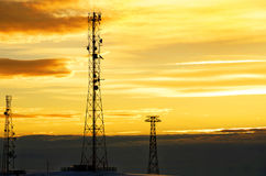 Silhouette view of cellphone antenna under twilight sky Royalty Free Stock Image