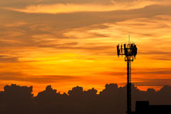 Silhouette view of cellphone antenna under twilight sky Stock Photography