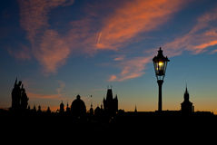 Silhouette view of Charles Bridge and city of Prague at dawn Royalty Free Stock Photos