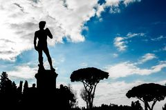 Silhouette view of David sculpture at Florence. Silhouette view of David sculpture at Florence with blue sky in background Stock Images