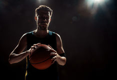 Free Silhouette View Of A Basketball Player Holding Basket Ball On Black Background Stock Photos - 75887813