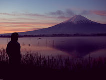 Silhouette view from 25s to 35s man see sunrise from kawaguchi l. Ake and fuji mountain background from japan Stock Images