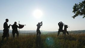 Silhouette of a Vikings practicing using the sword for battle. stock footage