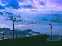 silhouette vintage asia architecture on lamp post on asia beautiful contry road with cloudy twilight sky after sunrise background royalty free stock images