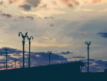 silhouette vintage asia architecture on lamp post on asia beautiful contry road with twilight sky after sunrise background from t royalty free stock photos