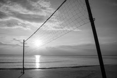 Silhouette Volleyball net on sand beach with beautiful sunset in twilight time. royalty free stock photo