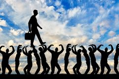 Silhouette of a walking selfish and narcissistic man on the hands of the crowd. The concept of selfishness and narcissistic personality Stock Photos