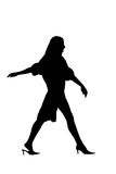 Silhouette walking woman. Over white Stock Photo