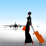 Silhouette of walking woman in airport Stock Photos