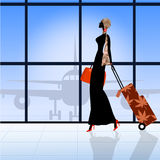 Silhouette of walking woman in airport.  Royalty Free Stock Images