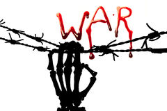 Silhouette of WAR. War in bleeding letters and a silhouette of a skeleton hand holding barbed wire Royalty Free Stock Photos