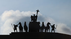 Silhouette of war. Statues on a triumphal arch in the Winter Palace square, St. Petersburg, Russia Stock Photos