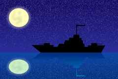 Silhouette of warship at night Stock Photo