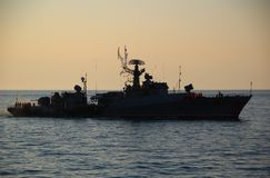 Silhouette of a warship in the night Stock Images
