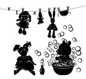 Silhouette washing toys Royalty Free Stock Image