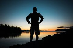 Silhouette, Water, Standing, Sunrise Stock Photography