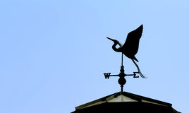 Silhouette of a Weathervane Stock Photo