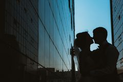 Silhouette Wedding couple on background mirror buildings.  royalty free stock photos