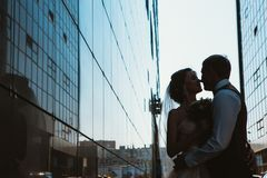 Silhouette Wedding couple on background mirror buildings.  stock photography