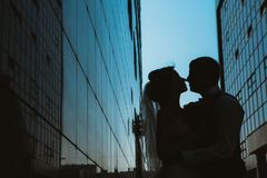 Silhouette Wedding couple on background mirror buildings.  royalty free stock photo