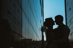 Silhouette Wedding couple on background mirror buildings.  stock photo