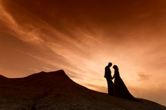 Silhouette of wedding couple with the red sunset Royalty Free Stock Image