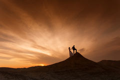 Silhouette of wedding couple with the red sunset Stock Images