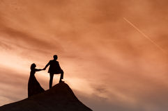 Silhouette of wedding couple with the red sunset Stock Image