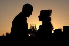 Silhouette of wedding couple at sunset Stock Photos