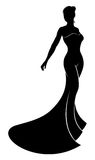 Silhouette Wedding Dress Bride. Silhouette bride in her beautiful bridal wedding dress Royalty Free Stock Photo
