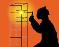 Silhouette of a welder. Black silhouette of a welder on an orange background Royalty Free Stock Photo