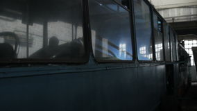 Silhouette of welder workers at trolleybus. Technical station stock video footage