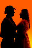 Silhouette western couple holding each other Stock Photography