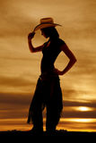 Silhouette western woman profile tip hat. A silhouette of a woman in her western wear Royalty Free Stock Images