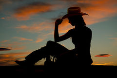 Silhouette western woman side sit tip hat Stock Photos