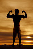 Silhouette wet man muscles flex both arms up Royalty Free Stock Image