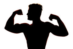 Silhouette wet man muscles flex look side Stock Photos