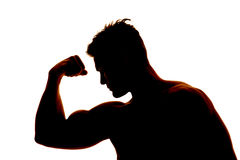 Silhouette wet man muscles flex one arm Stock Image