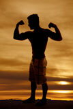 Silhouette wet man muscles standing flexing Stock Image