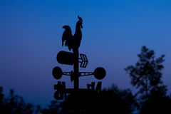 Silhouette wheather vane at dawn Stock Photo