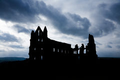Silhouette of  Whitby Abbey with Moody Sky Royalty Free Stock Photos