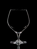 Silhouette of white whiskey glass with clipping path on black background Royalty Free Stock Photos