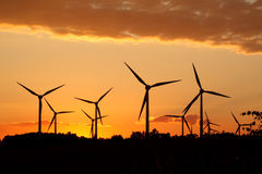 Silhouette of wind power station Stock Photos