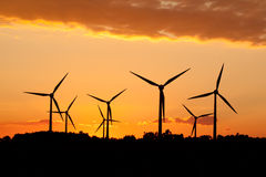 Silhouette of wind power station Stock Images