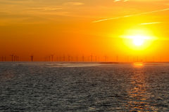 Silhouette of wind power station. Stock Photos