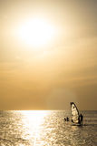 Silhouette of a wind-surfer on waves sunset. Silhouette of a wind-surfer on waves of a gulf on a sunset Royalty Free Stock Photos