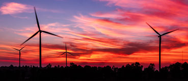 Silhouette wind turbine with dusk Stock Photos