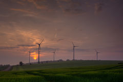 Silhouette of wind turbine generating electricity on sunset.  royalty free stock photos