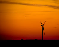 Silhouette of  wind turbine at sunset Royalty Free Stock Photos