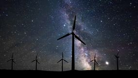 Silhouette of wind turbines against the starry sky. Milky Way, timelapse. Silhouette of wind turbines against the starry sky. Milky Way, timelapse stock video